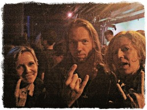 Mari and me with Tyr lead singer Heri Joenson, whose heavy metal salute is much more polished than ours