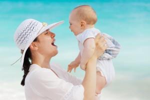 Happy mom with cherub